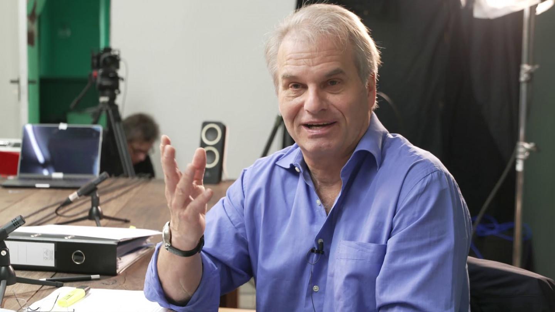 Д-р Рaинер Фуелмих во разговор со Д-р Питер А. Мекалоу