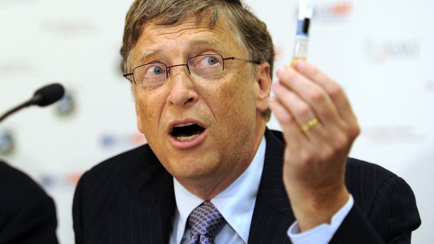 Billionaire philanthropist Bill Gates holda up a Rotavirus vaccine during a news conference at the Global Alliance for Vaccines and Immunisation conference in London